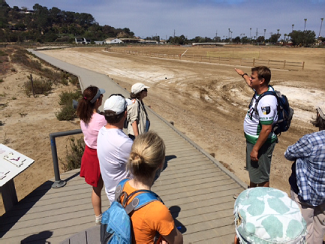 Mark points out how boardwalk on part of the trail continues toward the coast